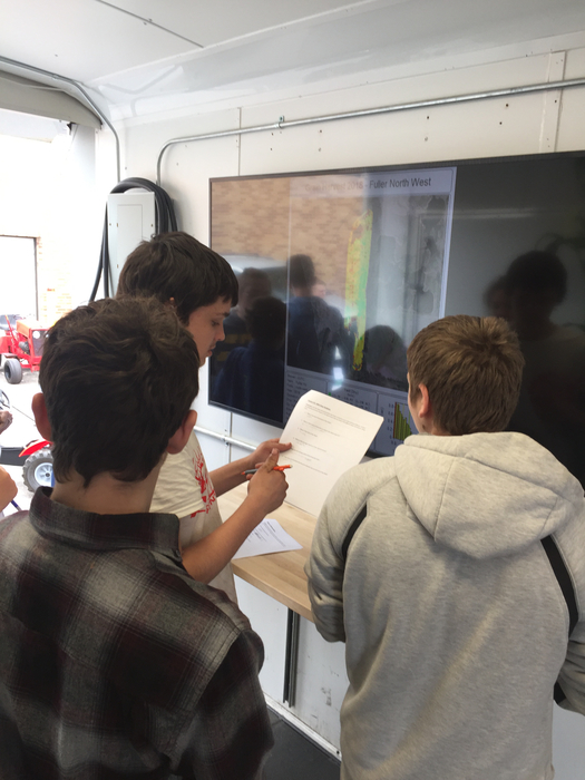 3 students working with the Mobile Lab
