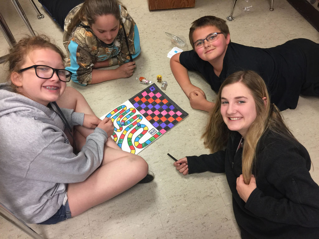 students making a game board