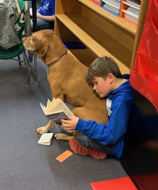 Jethro loves reading with our students!